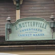 J. Nutterville sign during the day.