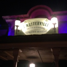 J. Nutterville sign at night.