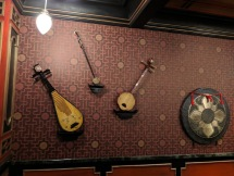Musical instruments on the wall of a dining room.