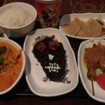 This was served in October 2015. You had a vegetarian balinese curry on the left, rice, skull shaped sticky rice in the middle and chicken satays on the right.