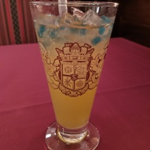 Magellan's signature drink, served in a souvenir glass