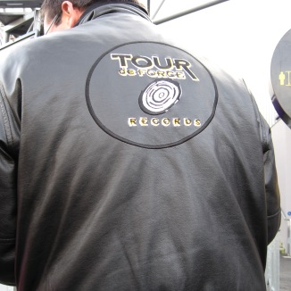 Cast members wore jackets with the Tour de Force Records logo